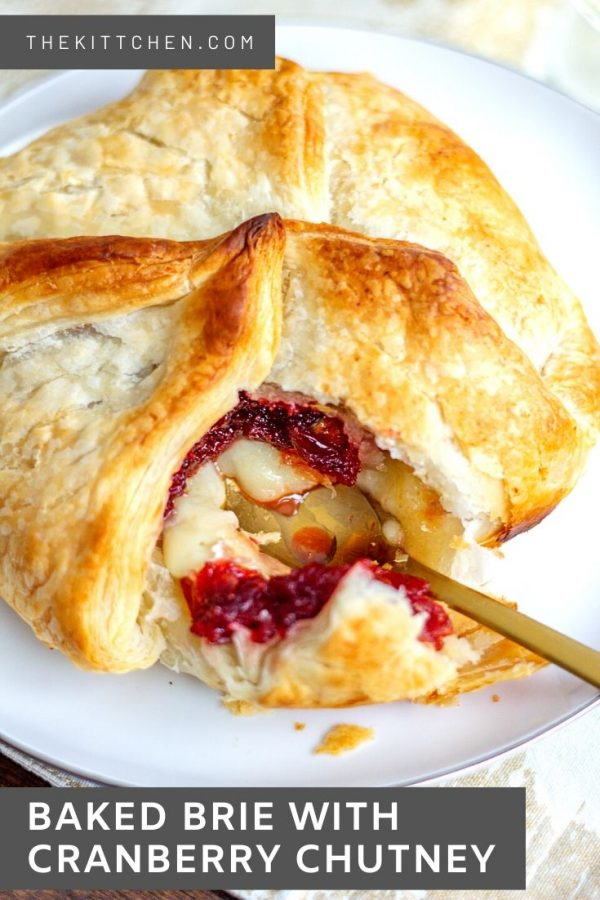 Baked Brie with Cranberry Chutney is made with a wheel of brie that is topped with a simple homemade cranberry chutney and then wrapped in puff pastry and baked.